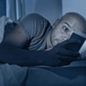 young cell phone addict man awake at nig