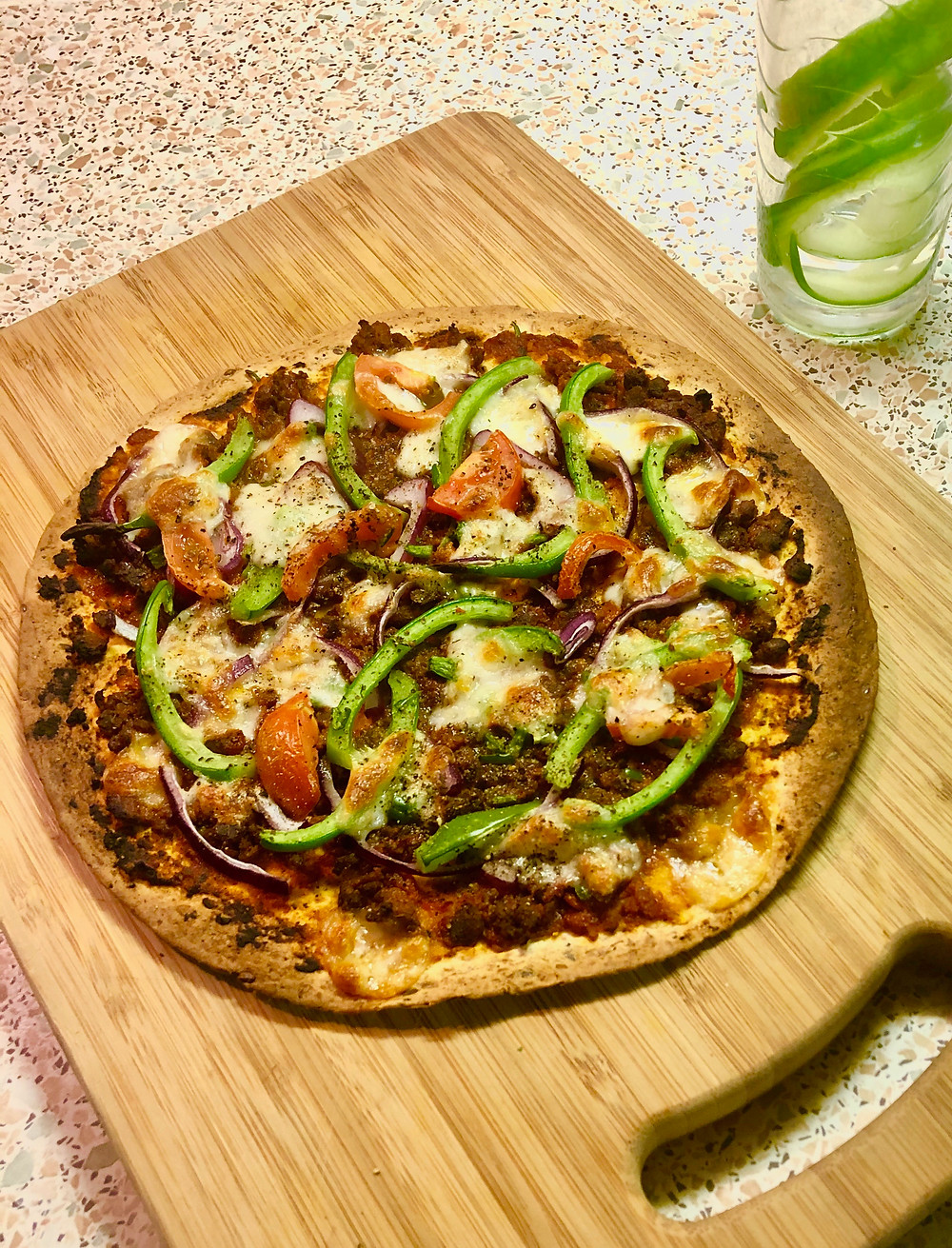 Homemade pizza on board