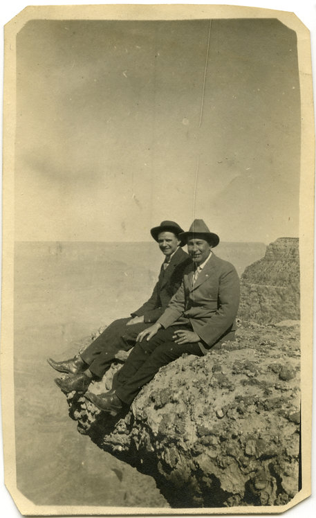 Two Men On Canyon Cliff