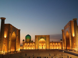 13 Uzbekistan Samarkand Panoramic view of illuminated Registan square ST