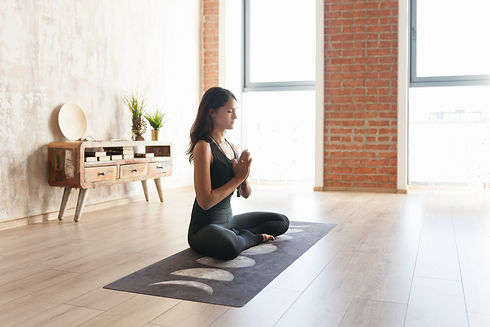 Pretty young woman yoga instructor medit