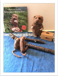 Bertram likes to sew stick weaving