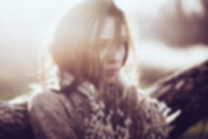 Woman looking sad, depressed or contemplative.