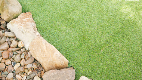 synthetic grass near rocksjpg.jpg