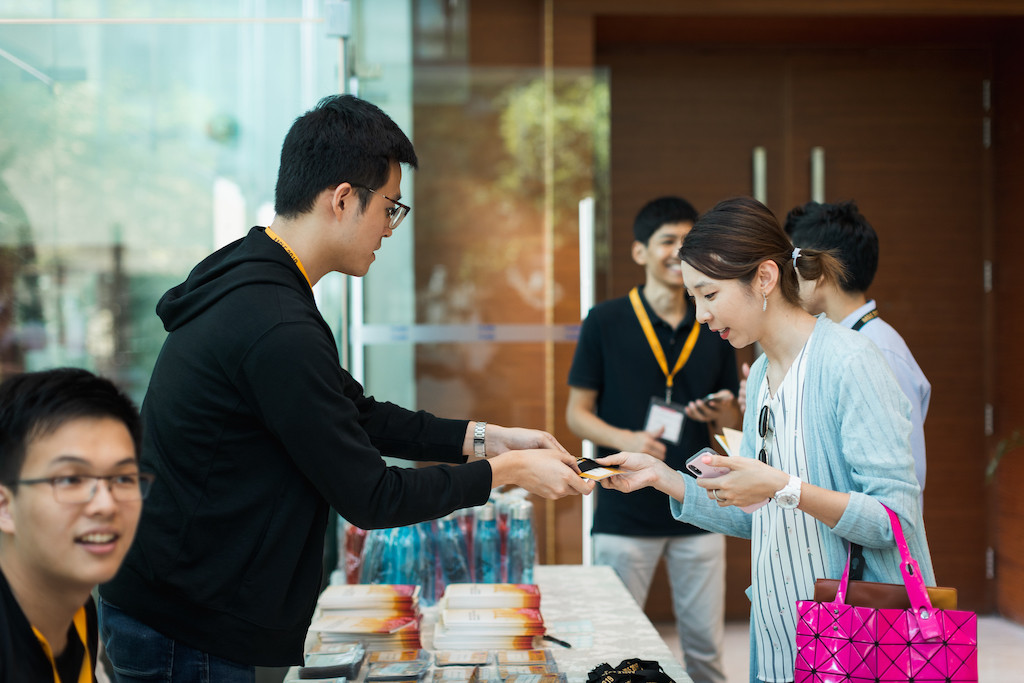 Conference delegates registering and receiving conference goodies.