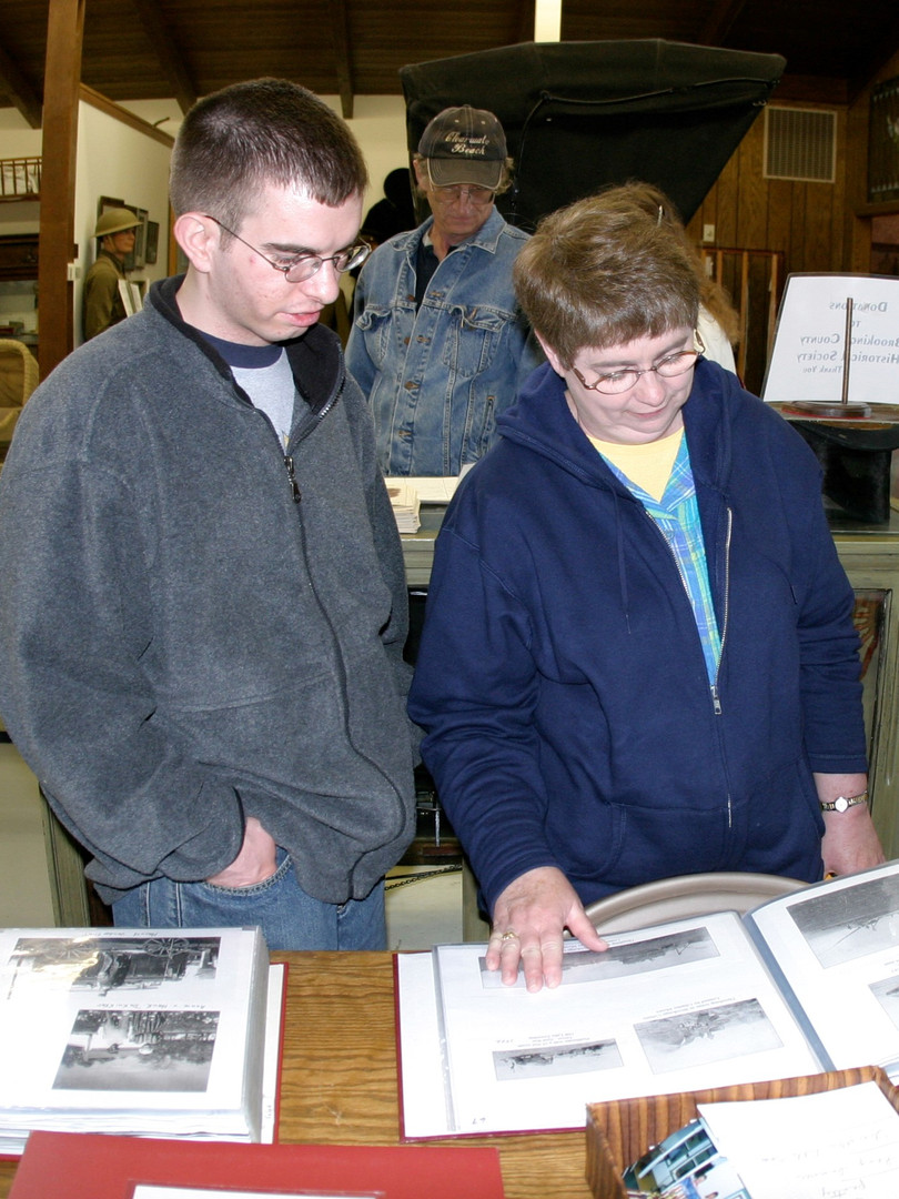 People looking at scrapbooks