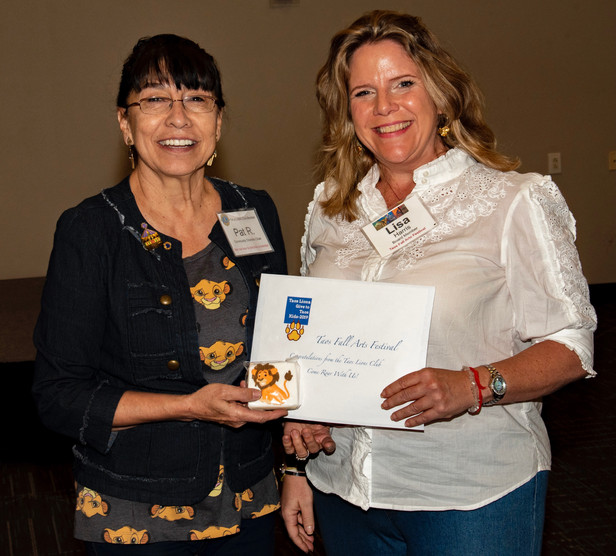 Lisa Harris, Board Member of Taos Fall Arts Festival, is presented with their grant at the Annual Taos Lions Gives to Taos Kids Luncheon.