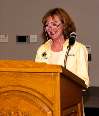Lions Member and Past President, Cindy Atkins, presents awards to Taos non-profits.