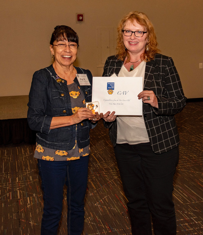 Malinda Williams, Director of Community Against Violence, receiving their Grant at the Annual Taos Lions Gives to Taos Kids Luncheon.