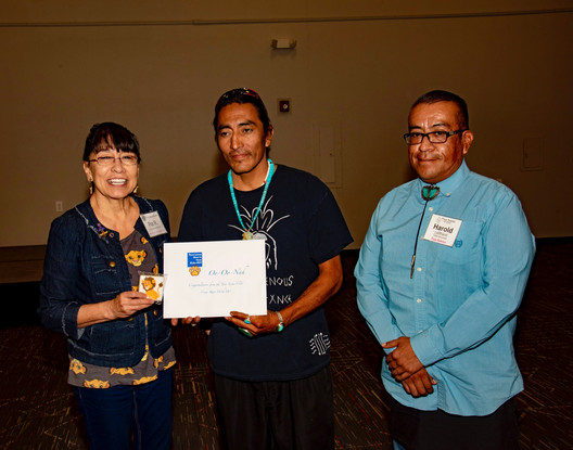 Oo-Oo-Nah receiving their grant for the work they do with Taos kids at Taos Pueblo, Harold Lefthand is present.