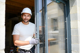 handsome young man installing bay window