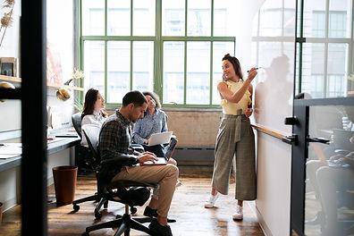 Small team person at white board shutter