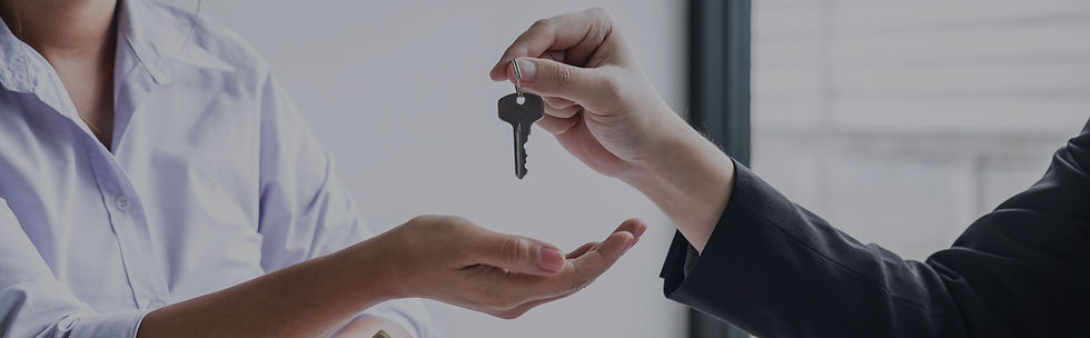estate-agent-giving-house-keys-to-client