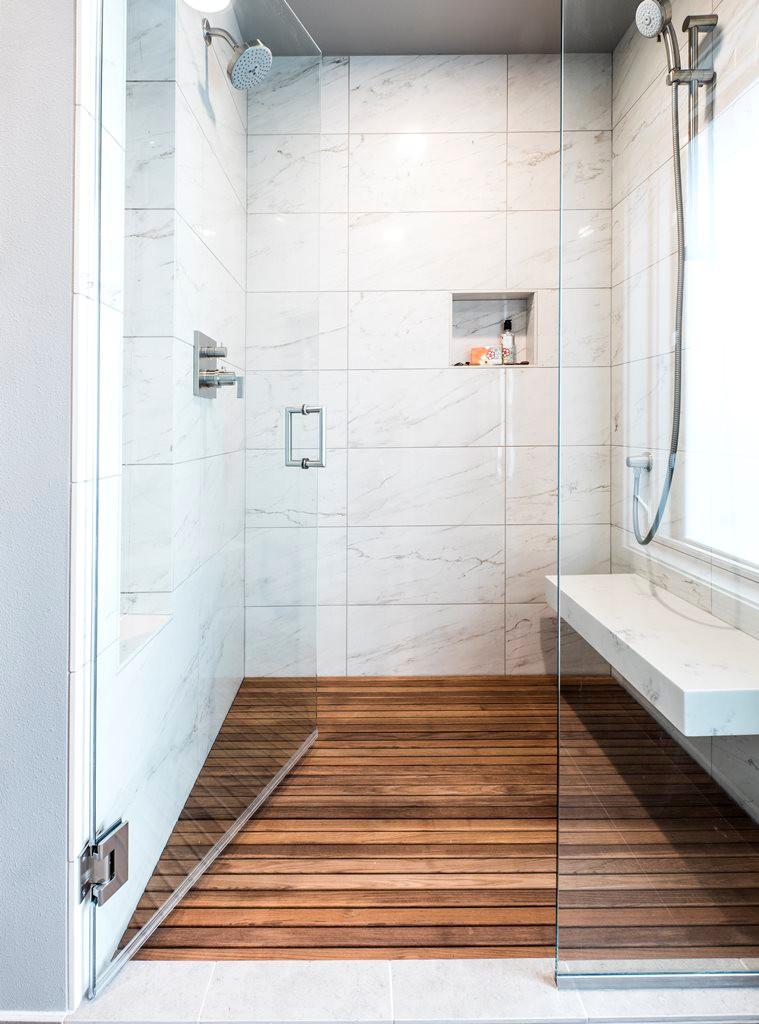 Master shower with slab bench and teak floor