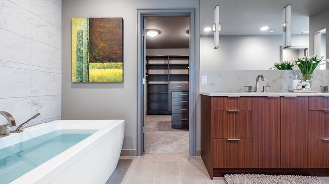 Master bath with view into closet