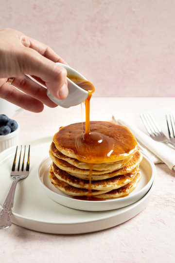 pouring syrup in a pancake