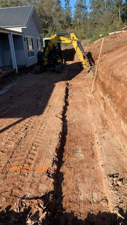 Preparations for sandstone retaining wall with SDH Concrete & Carpentry