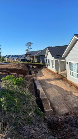 Sandstone retaining wall with SDH Concrete & Carpentry