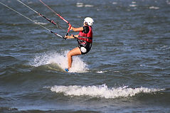 Intermediate kiteboarder riding upwind on Ometepe lake
