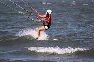 Intermediate kiteboarder riding upwind on Ometepe lake