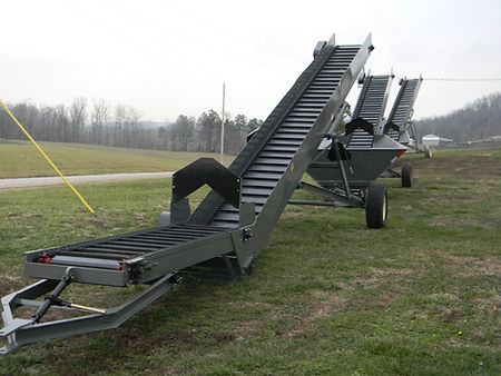 This is a picture of 3 differant models of conveyors.  Shows the adjustable flow gate and also the heavy duty New Holland chain and cleats that we use.