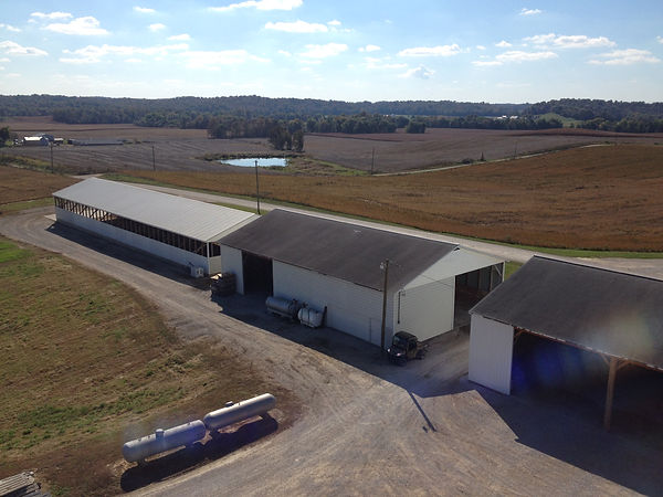 This picture overlooks the old hog houses that we lifted ourselves to use for machine storage since we got out of the hog business in 2006.