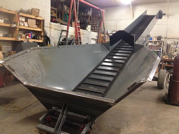 Custom designed litter conveyor.  Built to work best in your operation.