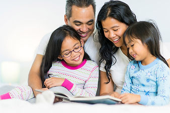 asian-family-reading-in-bed-ages4-7.jpg