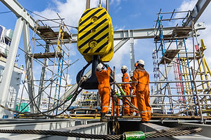 Offshore construction workers handling s