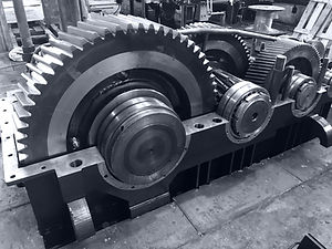 large gearbox open, showing the gears, t