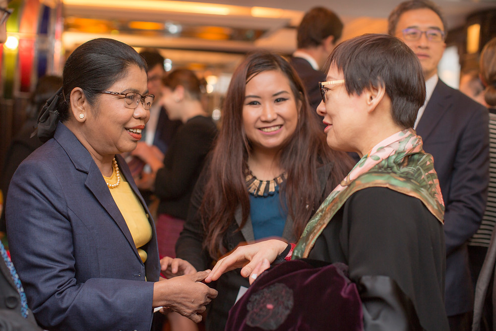 Belt and Road Commissioner Ms Yvonne Choi (right) conversing with Yangon City Development Committee member Daw Than Myint Aung (left)