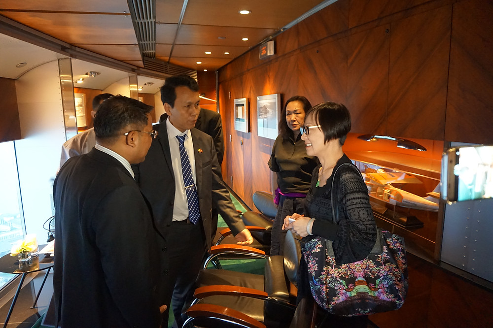 Yvonner Choi (rightest), Commissioner for  Belt and Road, talking with Chief Minister.
