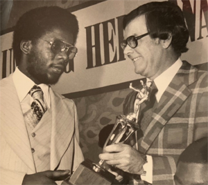 Wayne Hill in 1977 as he received his Unsung Hero honoree trophy from Charles Perry McCormick, Jr. (aka Buzz McCormick), son of the event's late founder, Charles Perry McCormick.