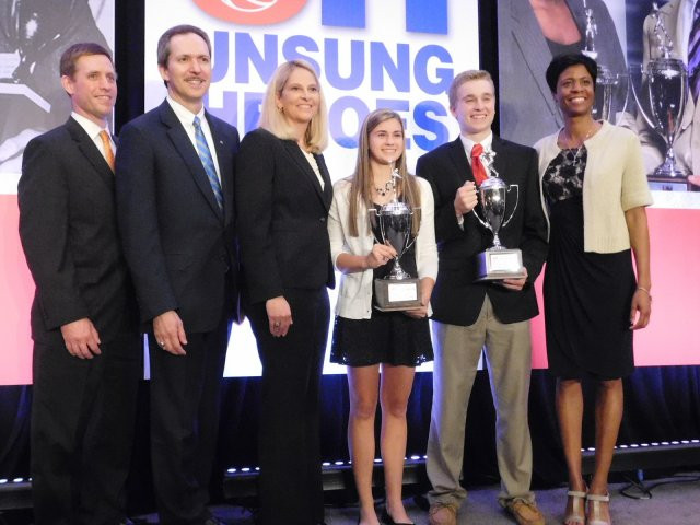 McCormick Community Relations Manager Jason McCormick (left), McCormick President & CEO Lawrence Kurzius, University of Maryland women's basketball coach Brenda Frese, Sparrows Point senior Alyssa Rasmussen, Concordia Prep senior Joseph Schildwachter and McCormick Vice President of Communications & Community Affairs Lori Robinson pose for pictures after the 76th McCormick Unsung Heroes Awards Banquet Monday evening in Cockeysville. Schildwachter and Rasmussen were rewarded with a Charles Perry McCormick College Scholarship.