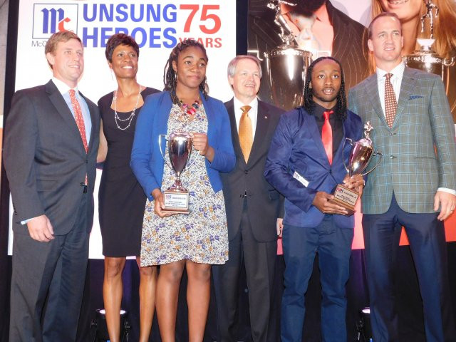 (From left) Jason McCormick (grandson of event founder Charles P. McCormick), Lori Robinson (McCormick VP of Corporate Communications), Eastern Tech's Dunsin Fadojutimi (female Unsung Hero), Alan Wilson (McCormick CEO),  Alcedo Hodge from Maritime Academy (male Unsung Hero) and Denver Broncos quarterback Peyton Manning, at the 75th annual McCormick Unsung Heroes Dinner.