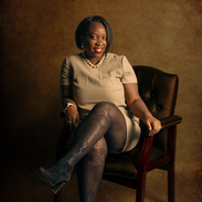 black woman in chair fishnet stockings.p
