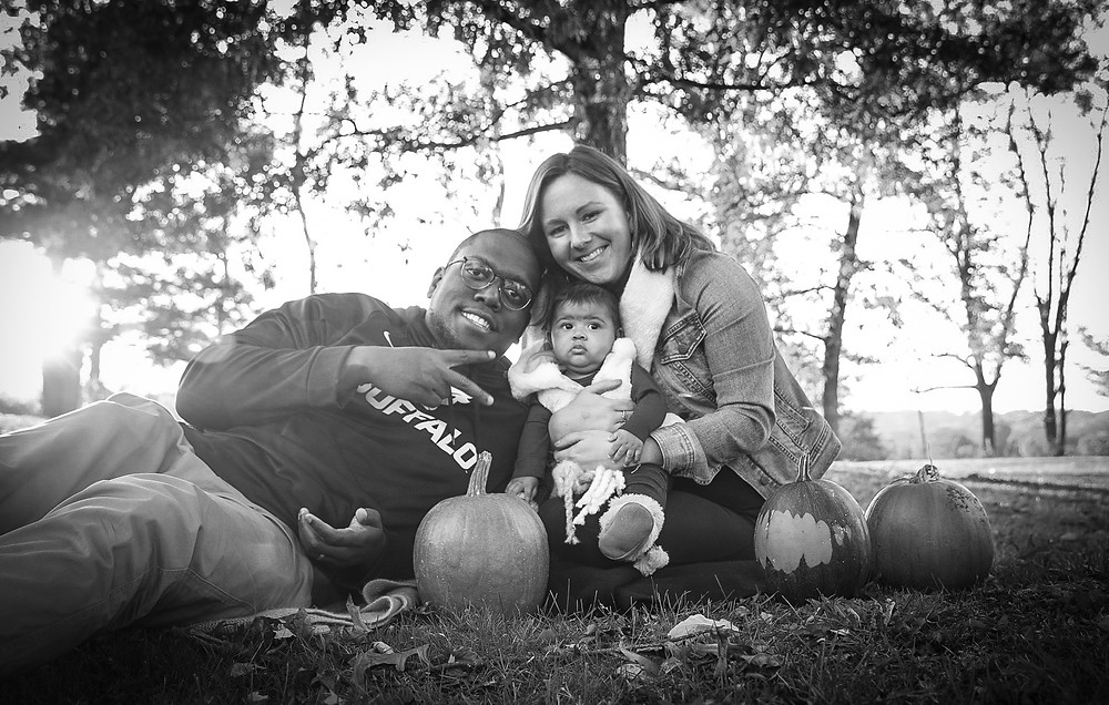 family portrait outside on a fall day.