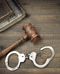Real Judges Gavel, Handcuffs And Old Leg