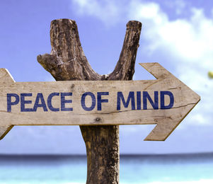 Peace of Mind wooden sign with a beach o
