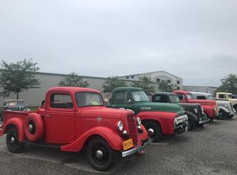 meet row of cars pickups.jpg