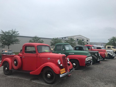 meet row of cars pickups.jpg