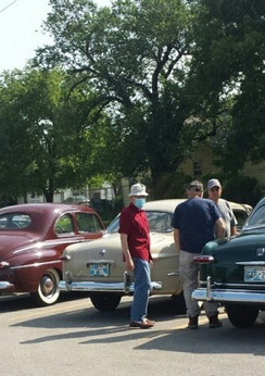 Row of old cars and members.jpg