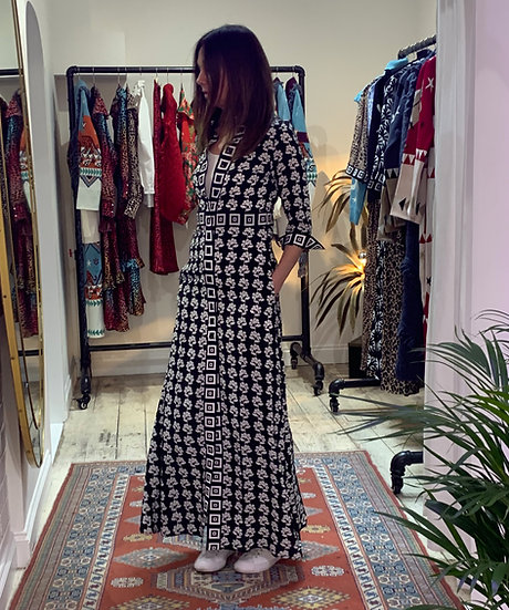 brunette client trying on long shirt dress in gorgeous print at Hayley Menzies