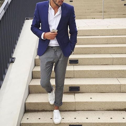 stylish guy in crisp casual outfit waking down steps