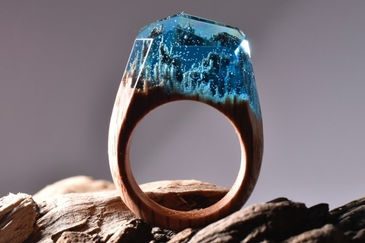 stunning and original wooden ring with clear blue resin stone