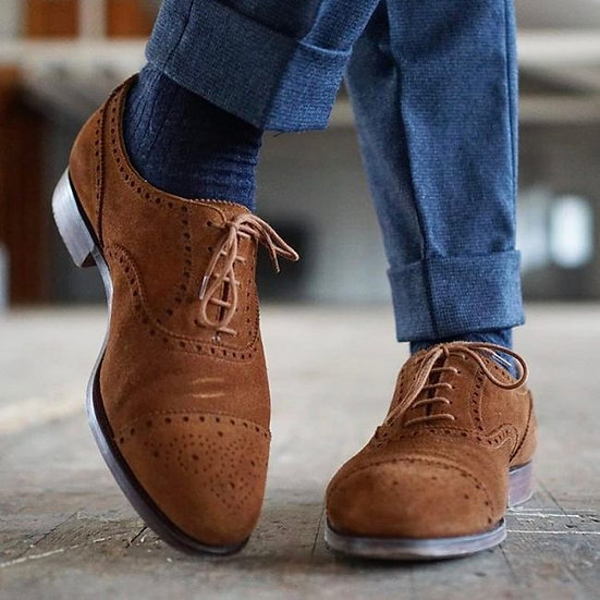 brown suede brogues with blue flannel trousers