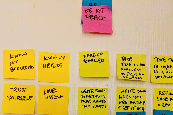 Lisa used Post-It notes to list and prioritize her smart goals.