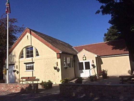 Photo of Kirkby Fleetham Village Hall with vivid blue sky