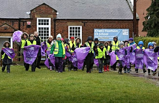 Photo of Primary School children from Kirkby Fleetham starting on a litter pick
