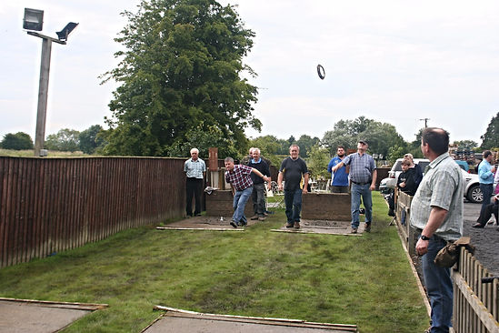 Photo of a game of Quoits at the back of the Black Horse Inn